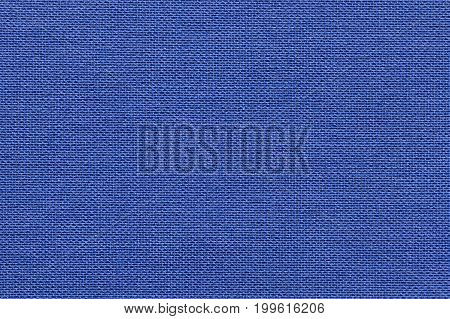 Navy blue background from a textile material with wicker pattern closeup. Structure of the denim fabric with natural texture. Cloth backdrop.