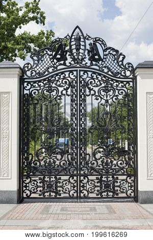 Beautiful wrought gates. Image of a decorative cast iron gates. metal gates close up. beautiful gates with artistic forging.Image of god and angels
