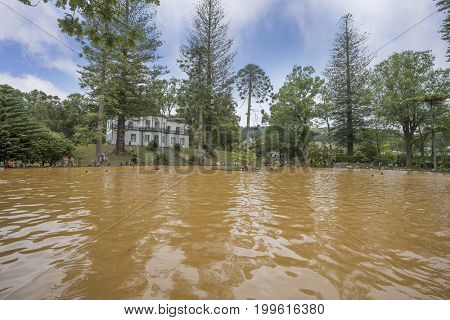 FURNAS, SAO MIGUEL, AZORES - AUGUST 10, 2017: People swimming in the hot thermal waters in Parque Terra Nostra