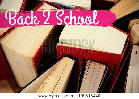 Back to school text against white background against close-up of various hardcover book