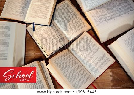 Back to school text over white background against close-up of various open book