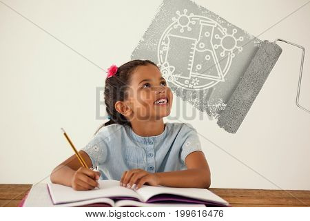 Graphic image of paint roller with beaker and flask against young girl writing in her book against white background