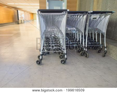 Three Row Of Luggage Cart Parking