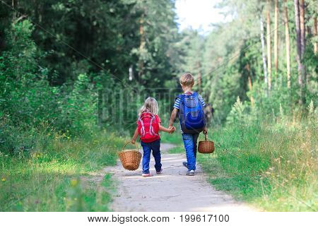 little boy and girl go to forest, kids seasonal activities