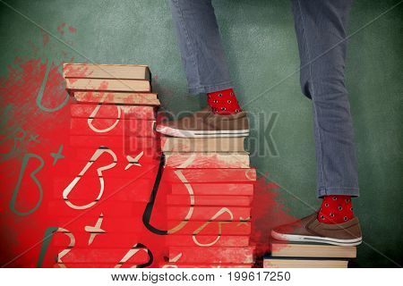 Graphic image of B plus grade against schoolboy climbing steps of books stack against chalkboard