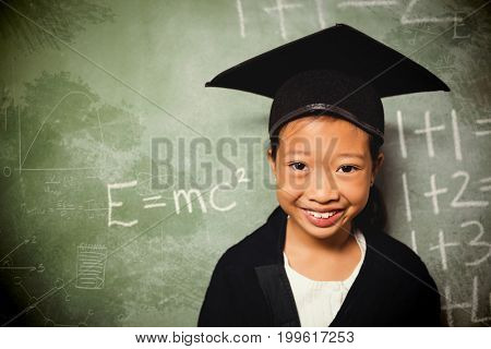 Graphic image of geometric diagrams against schoolchild wearing a graduation outfit