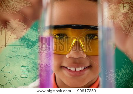 Graphic image of geometric diagrams against schoolboy experimenting against green background