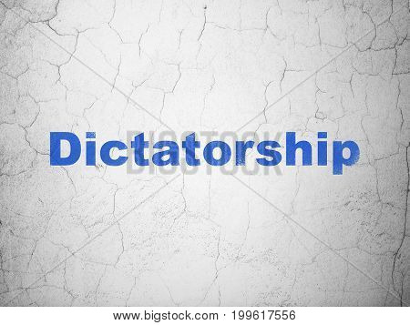 Politics concept: Blue Dictatorship on textured concrete wall background