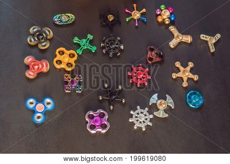 A Lot Of Different Spinners On A Black Background