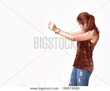 Beautiful young girl with handcuffs isolated on white background