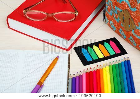 School Supplies. School Backpack, Book, Glasses, Color Pencils, Notebook With Pen And Color Bookmark