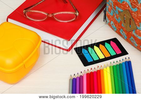 School Supplies. School Backpack, Book, Glasses, Color Pencils, Sandwich Box And Color Bookmarks On