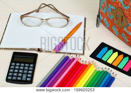 School Supplies. School Backpack, Color Pencils, Notebook With Glasses And Pen, Color Bookmarks And