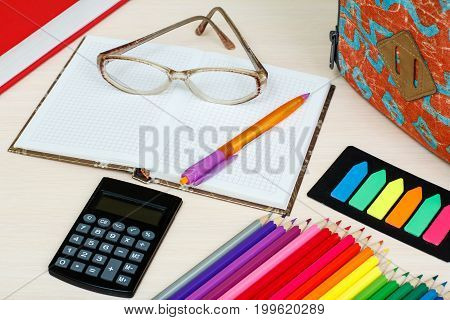 School Supplies. School Backpack, Book, Color Pencils, Notebook With Glasses And Pen, Color Bookmark