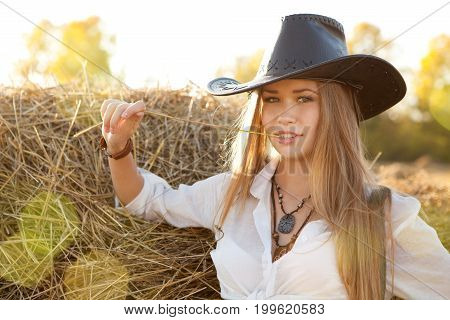 Portrait Of Woman In Hat At The Field.