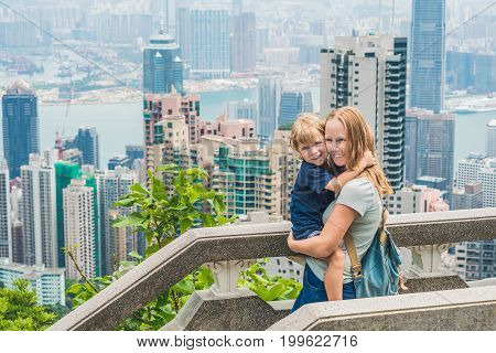 Mom And Son Travelers At The Peak Of Victoria Against The Backdrop Of Hong Kong. Traveling With Chil