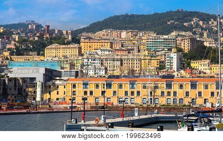 Port of Genoa (Genova) Italy. View from the sea towards the old town on a summer sunny day. Marina harbor and pier. Tourist destination. Center of the Ligurian Riviera.