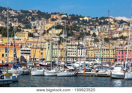 Port of Genoa (Genova) Italy. View from the sea towards the old town on a summer sunny day. Harbor yachts at the pier. Point of interest. Center of the Ligurian Riviera.