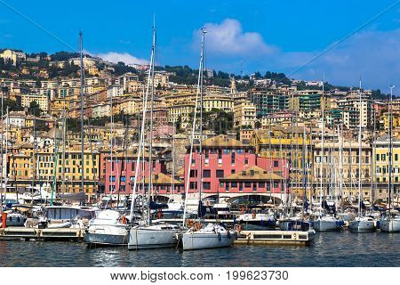 Port of Genoa (Genova) Italy. View from the sea towards the old town on a summer sunny day. Harbor yachts at the pier. Tourist destination. Center of the Ligurian Riviera.