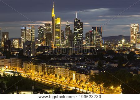 Frankfurt am Main - business capital of Germany at night. Top view of the business center: illuminated skyscrapers buildings and city streets in the night lights.