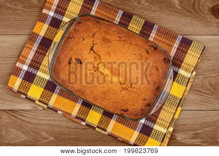 Delicious homemade cake on wooden background close-up top view