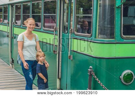 Mom And Son Are Going To Go On An Old Tram. Traveling With Children In Hong Kong Concept