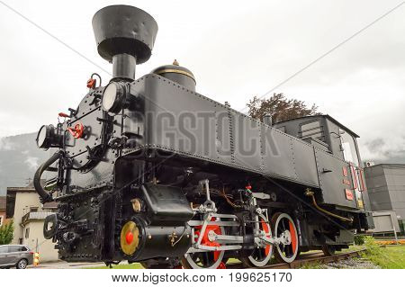 Old steam locomotive on track in Austrian tyrol