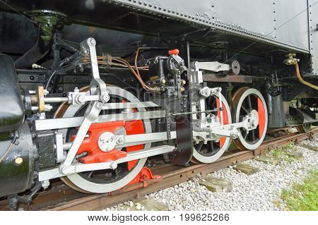 Mechanism of an old steam locomotive on a railway in the Austrian Tyrol