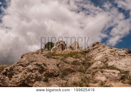 Rock On Sky Background With Clouds. Mountain Background