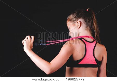 Young Fitness Girl With Skipping Rope On Black Background. Sport Or  Healthy Lifestyle Concept