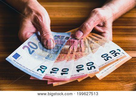 Euros in hands of senior. Pension conceptual