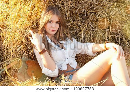 Beauty Woman Relaxing In The Straw In Field