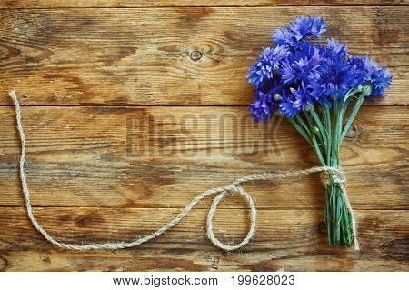 summer bouquet cornflowers tied rope on wooden table greeting card rustic style
