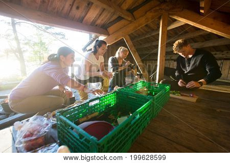 Multiethnic Friends Preparing Snacks In Shed