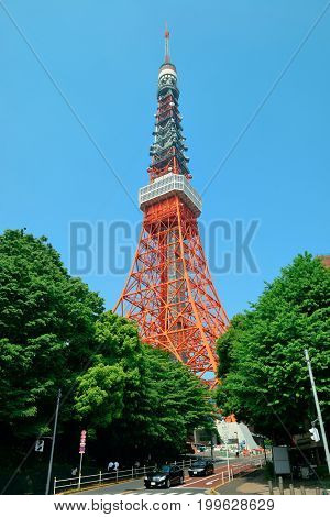 TOKYO, JAPAN - MAY 15: Tokyo Tower closeup with road on May 15, 2013 in Tokyo. Tokyo is the capital of Japan and the most populous metropolitan area in the world