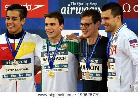 Hong Kong China - Oct 30 2016. ORTIZ-CANAVATE Miguel (ESP) SANKOVICH Pavel (BLR) LARKIN Mitch (AUS) and DONETC Stanislav (RUS) at the Victory Ceremony of Men`s Backstroke 50m. Swimming World Cup