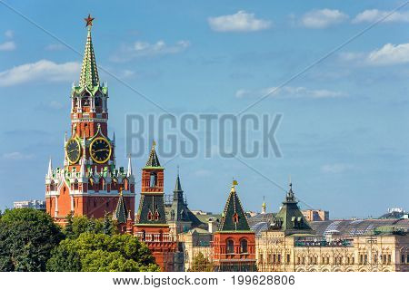 The Moscow Kremlin with the Spasskaya tower in the Red Square, Russia. The Moscow Kremlin is the residence of the Russian president and the main tourist attraction of Moscow.