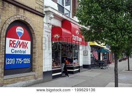 CADILLAC, MICHIGAN / UNITED STATES - MAY 31, 2017:  One may buy toys at Toy Town, next to REMAX Central, on Mitchell Street in Downtown Cadillac.