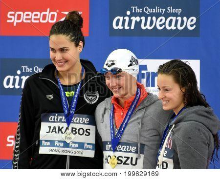 Hong Kong China - Oct 30 2016. JAKABOS Zsuzsanna (HUN) HOSSZU Katinka (HUN) and SAVARD Katerine (CAN) at the Victory Ceremony of the Women's Butterfly 200m. FINA Swimming World Cup.