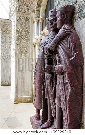 The ancient Portrait of the Four Tetrarchs by the St Mark`s Square in Venice, Italy. It is a porphyry sculpture group of Roman emperors dating from around 300 AD.