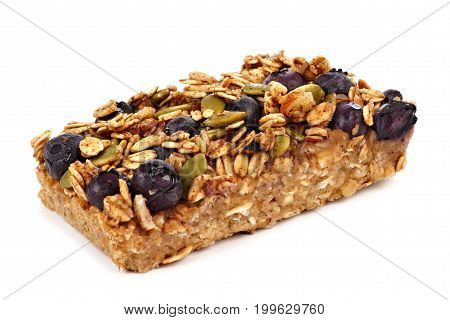 Homemade superfood breakfast bar with oats and blueberries isolated on a white background