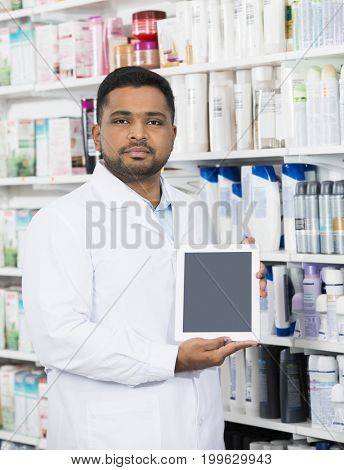 Chemist Holding Digital Tablet With Blank Screen