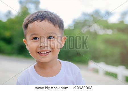 Portrait of happy Asian child toddler boy smiling close up looking at camera. Education Concept.