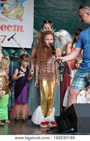 six years old Veronika Marevich in costume of little mermaid on traditional competition for title Best Beautiful Mermaid on