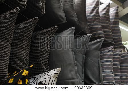 Cushions on the rack in the closet.
