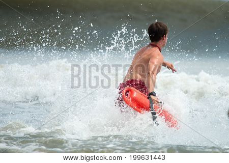 MARGATE CITY, NJ - AUGUST 8: View of Margate City Lifeguard running into the Atlantic Ocean to rescue a swimmer in distress