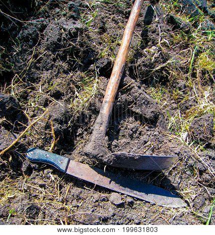 A hoe and a machete in Uganda rural area
