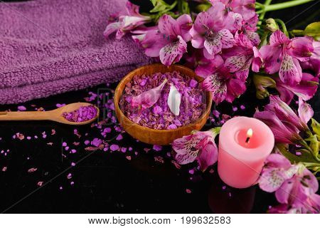 Spa background-towel, orchid, and spoon ,petals in bowl, salt in spoon