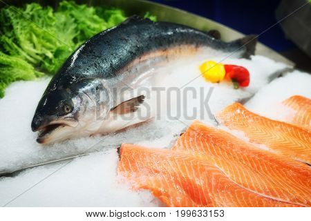 Fresh salmon on ice in a supermarket, toned image