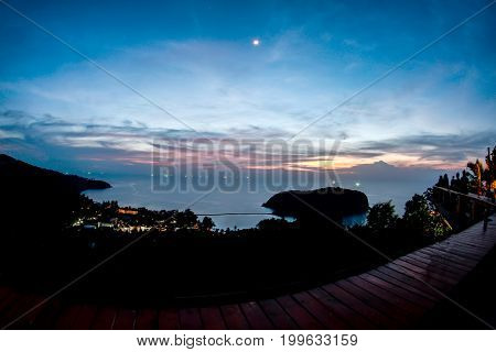 point sunset from top of mountain for see the blue sea waves surface and beach of koh ma koh phangan thailand